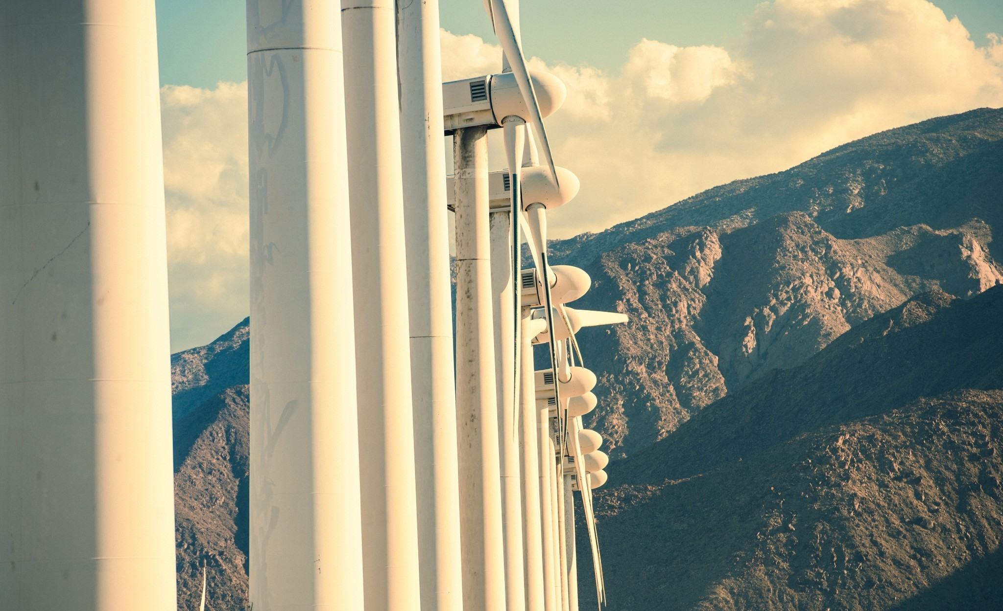 Wind Turbines and the Mountains. California Wind Energy Plant Closeup.